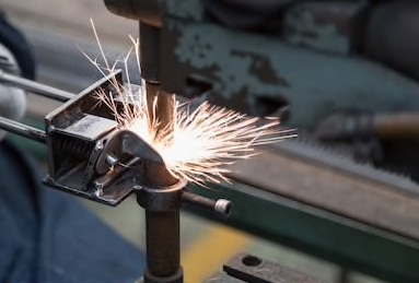 operator-working-spot-welding-process-260nw-711776452